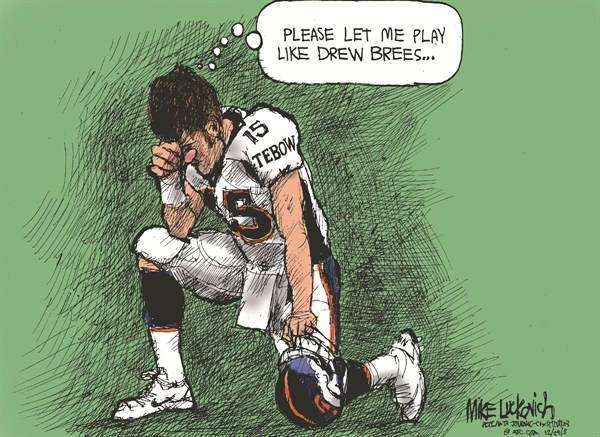 103759 600 Tebow and Brees cartoons