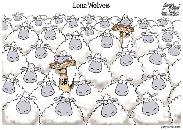 Lone Wolves © Gary Varvel,The Indianapolis Star News,wolves,sheep,clothing,isis terror,isis,fear