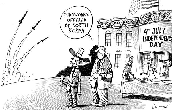 Patrick Chappatte - Le Temps, Switzerland - NORTH KOREA LAUNCHES MISSILES - English - USA, George, W, Bush, Nuclear, Proliferation, Atom, Bomb, North Korea, Independence Day, Korea, N. korea, Kim Jong il, atomic, power, weapons, weapon, fireworks, missiles, celebration, holiday
