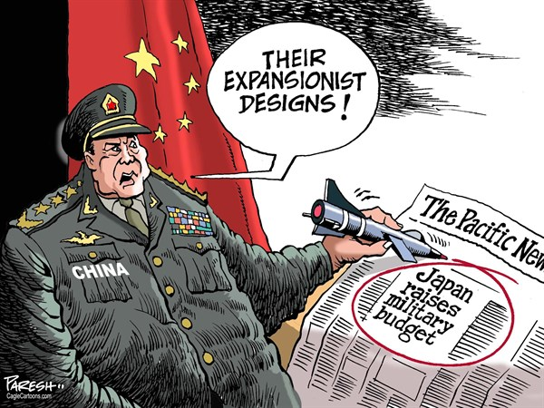 Paresh Nath - The Khaleej Times, UAE - China and Japan military COLOR - English - China military, South China sea, island row, dispute with neighbours, Japan military, defence budget, expansionist, air defence zone