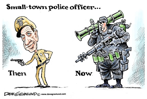 Dave Granlund - Politicalcartoons.com - Militarization of cops - English - police, armed, military arms, military surplus, M-16, swat, armored cars, heavy arms, barney fife, mayberry, small-town, small town police, heavily armed, browm ferguson, roit gear